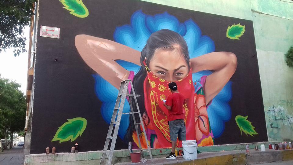 Photo of Grafiteros ponen pintura de niña rebelde sobre anuncio de Roberto López Rosado